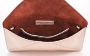 Wren & Roch Love Note Crossbody Clutch - Pristine interior view standing up with pocket and lining