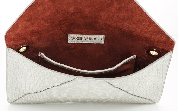 Wren & Roch Love Note Crossbody Clutch - Purity interior view standing up with pocket and lining