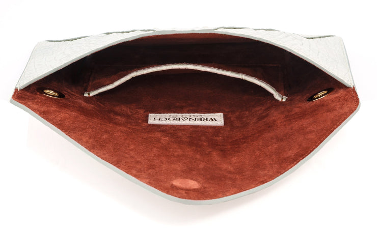 Wren & Roch Love Note Crossbody Clutch - Purity interior view laying down with pocket and lining