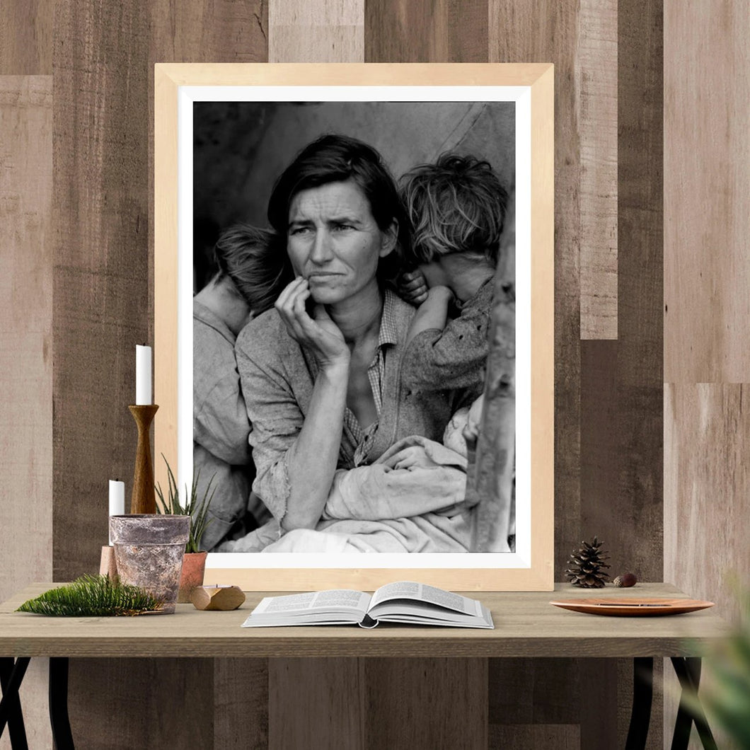Dorothea Lange's Migrant Mother Framed Hanging Above A Table