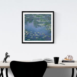 Claude Monet Water Lilies at Giverny Art Print Hanging Above A Desk