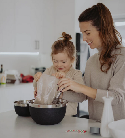 mom cooking with kid fun things to do for mothers day