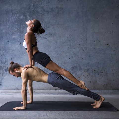 get mindful with yoga man and woman practising yoga