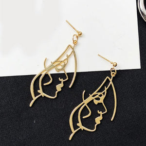 Faces shaped drop earrings - Dots Clothing Store