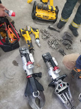 Load image into Gallery viewer, SHARE THE POWER. FLEXVOLT fire rescue kits share their batteries with AMKUS ion tools.