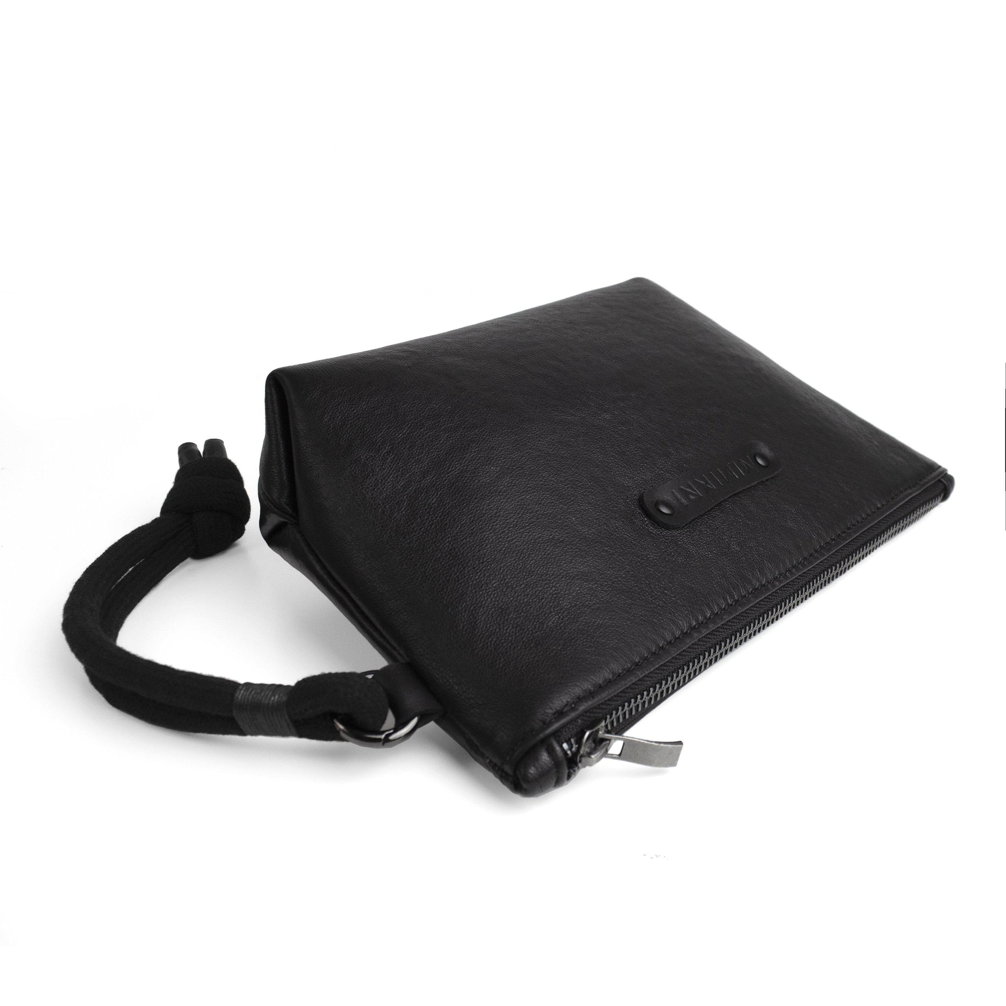 Black leather makeup / clutch bag
