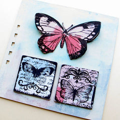 butterfly rubber stamped book page