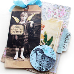 rubber stamped collage book page