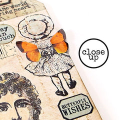 close up of rubber stamped art tag