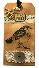 rubber stamped bird tag