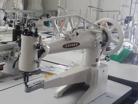 Consew 29BL Cobbler / Shoe Repair Machine.  Long arm, big bobbin, speed controlled servo motor.  Mounted on a USA Made sewing table and K leg stand.