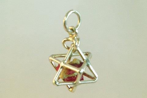 925 silver sacred geometry Tertra Pendant with raw ruby enclosed