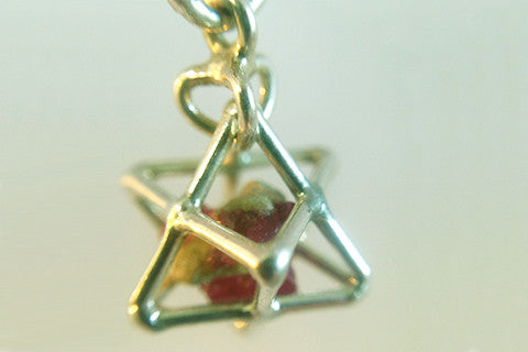 925 silver tetra with raw ruby enclosed