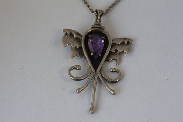 Beautifully Cut Amethyst GemStone with Artisanal Angel 925Silver Details