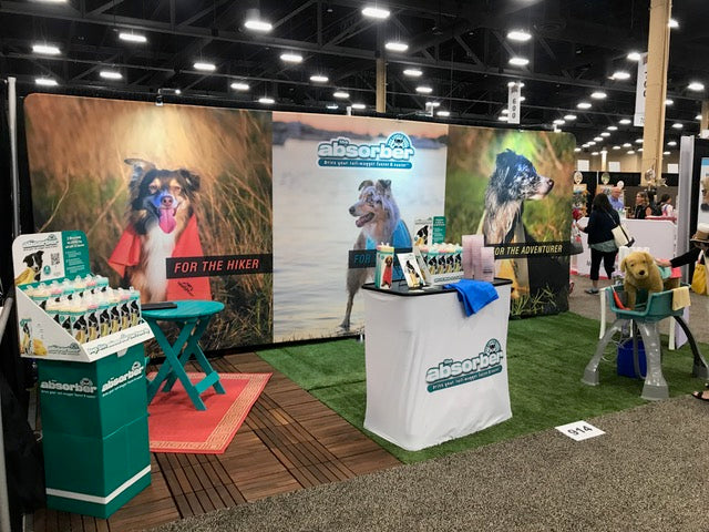 The Absorber Dog Lover's Towel at a tradeshow