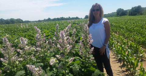 Suzanne in the Bulgarian valley where she sources her organic Clary Sage.