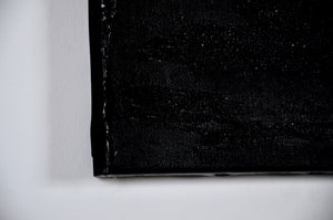 Corner Detail. Black acrylic is shown to wrap around the corner of the canvas covering the sides.