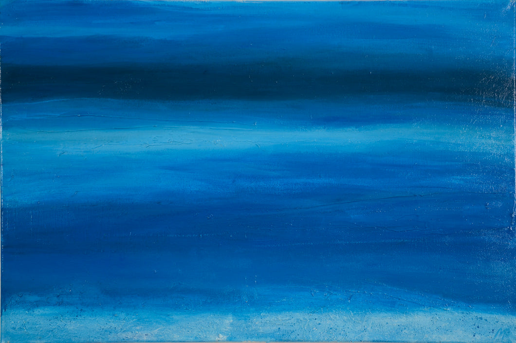 Deep blues, navy and white foam of the Red Sea