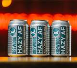 Three cans of Brewdog Hazy AF, the non-alcoholic IPA lager