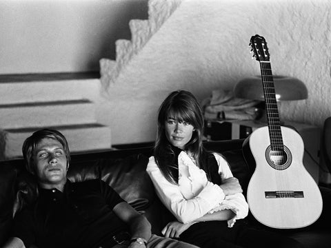 Francoise Hardy on the couch with guitar and man
