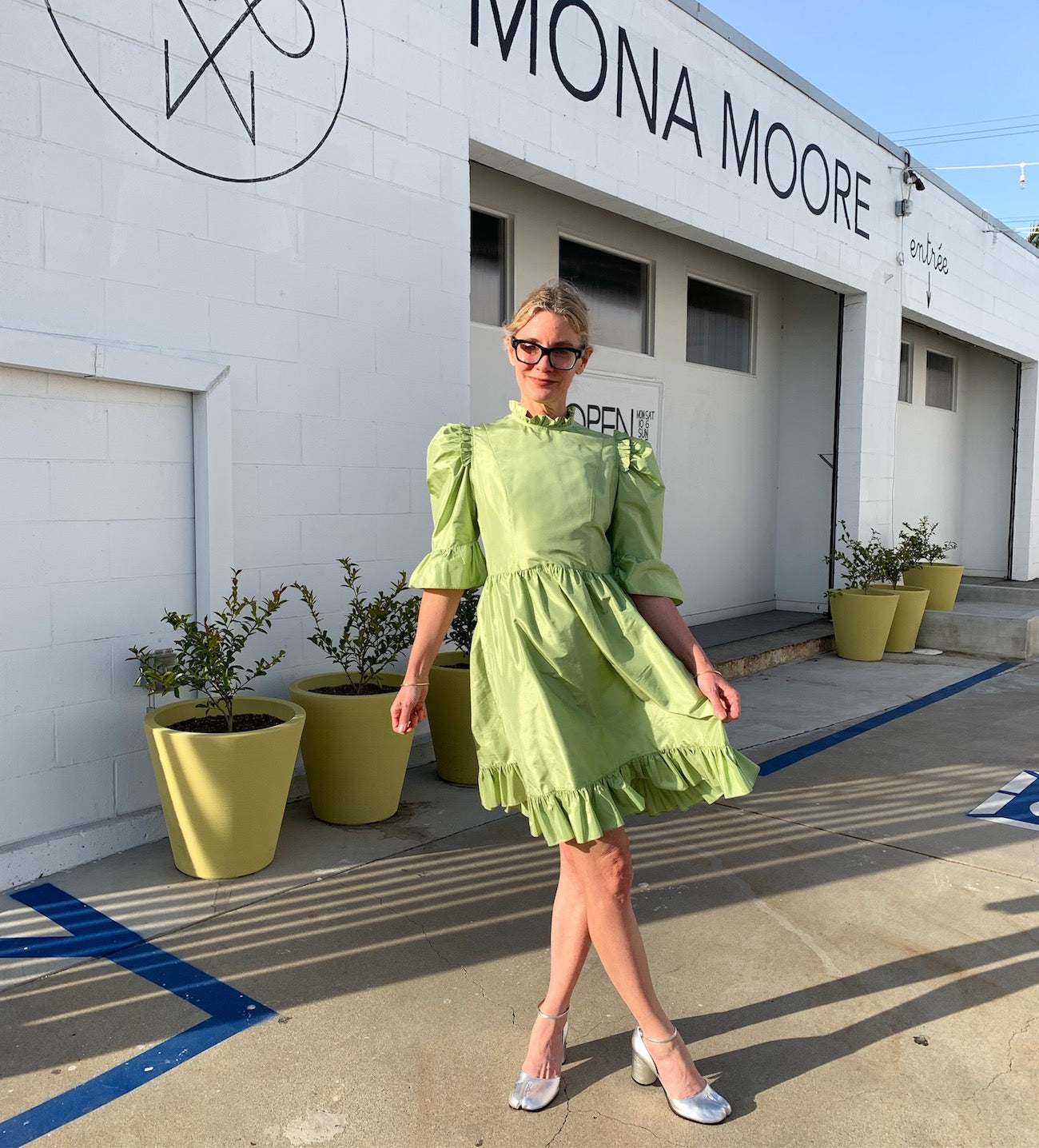 lisa bush in Batsheva SS19 dress outside Mona Moore