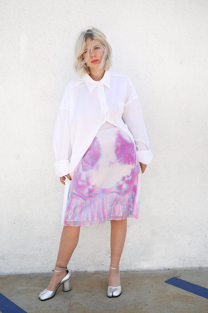 Techno Organza Skirt, Fluo Pink + Fluo Blue Maison Margiela ///Mid-length high waisted layered organza pencil skirt. Crafted from three layers of sheer material with a semi-opaque silvery white slip skirt beneath as the fourth layer. Each layer of organza features the same baroque inspired pattern, applied with a spray painted finish, but layered in a different color, with hints of the design beneath it and it's colors coming through. Top layer is in neon pink, mid layer is in cornflower blue, bottom layer is in cobalt blue. Together the layers create varying tones of blues, purples, and pinks.Top two layers are lefthovering around the fitted silhouette beneath,creating a floating illusion around the mid waist. Featuring elegant dart detailing at the front and back, with a hidden zip closure at the back. Mid-Length organza skirtBaroque inspired pattern detail Lined Dart detailingSlightly contrasting exposed white stitching throughout100% Polyester Made in ItalyWorn with Maiso Margiela Cotton Poplin ShirtRuns true to size, Ally is wearing a 40.
