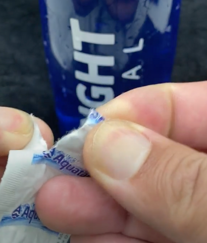 Opening a pack of Aquatabs Water Purification Tablets