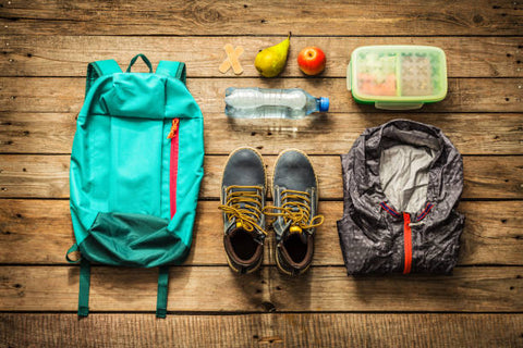 Packing a go-bag for hiking with extra food, clothes and water