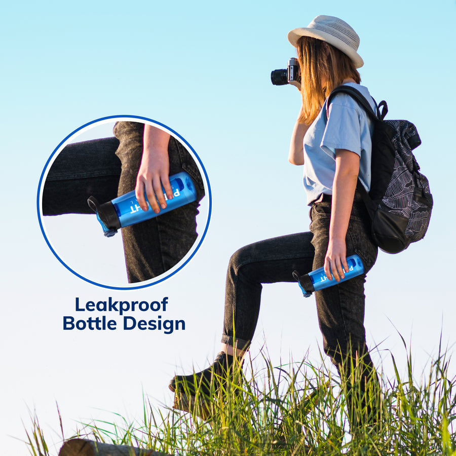 Woman hiking holding the Prep-Right Survival Water Filter Bottle upside down showing it has a leakproof bottle design