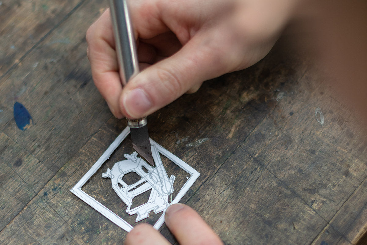 Cut Out Pieces of Cardboard Using A Scalpel