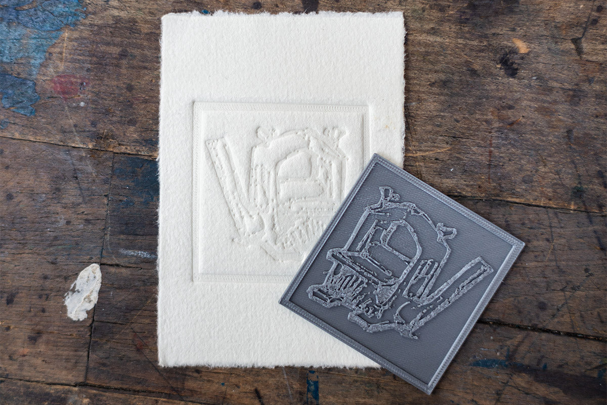 Image of a 3D Printed Plate and the Resulting Embossing