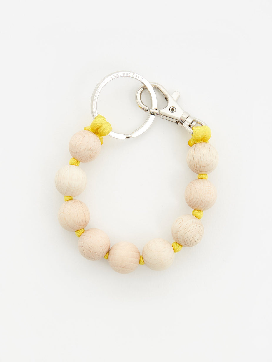 Ina Seifart Ina Seifart Dicke Perlen Short Key Holder - Natural/Yellow - Yellow