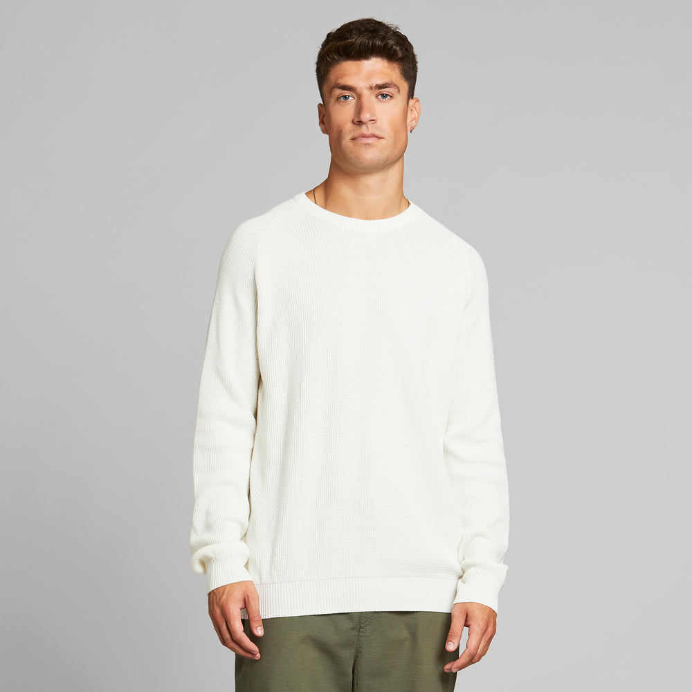 Product Photo of a Man wearing the Long Sleeve Kalmar Sweater by Dedicated.