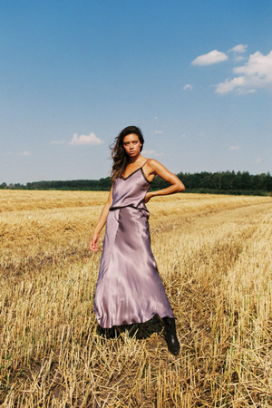 Girl wearing the Lana Long Skirt standing outside in a field.