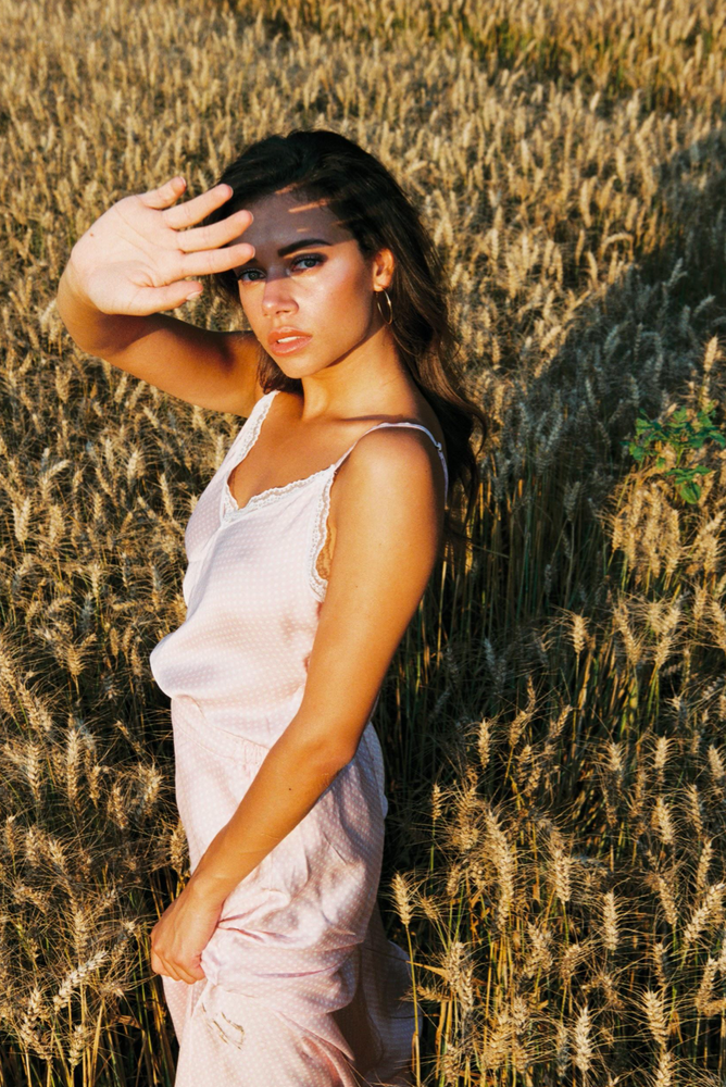 Load image into Gallery viewer, Girl wearing the Lou Singlet Top standing outside in a field.