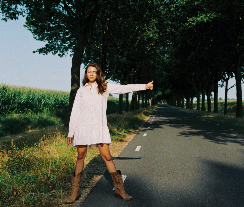 Photo of a girl standing in the road wearing the Summer Dress by Amaya Amsterdam.