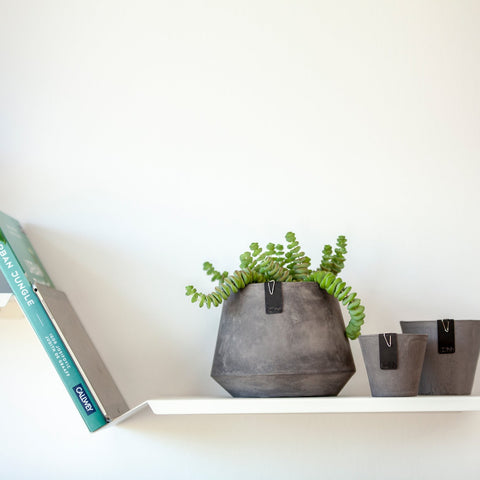 Plastic free, waterproof paper plant pot. In a concrete grey colour