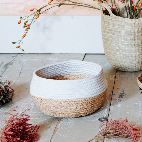 Natural sea grass storage basket in a natural and white contrasting colour block style.