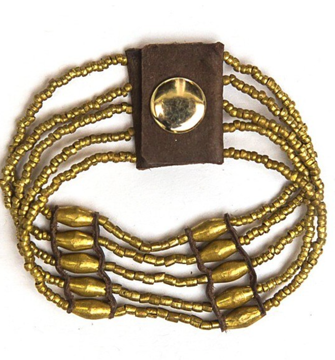 cuff like bracelet 5 strands all gold beads of varying sizes in a pattern with leather brown detailing and a snap closure