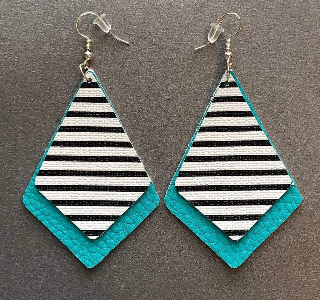 2 layered faux leather pieces both Dimond like shape bottom one larger bright teal/blue-green color top smaller black and white striped pattern Dimond like shape
