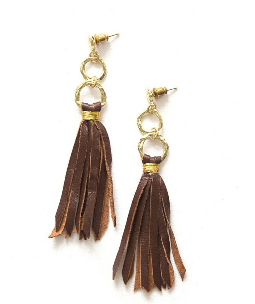 2 gold hammered circled connected with a jumping multi strands of brown leather tied to the hoop with gold color wire looks like brown ringe earrings with 2 circled with hammered detailing wears like studs