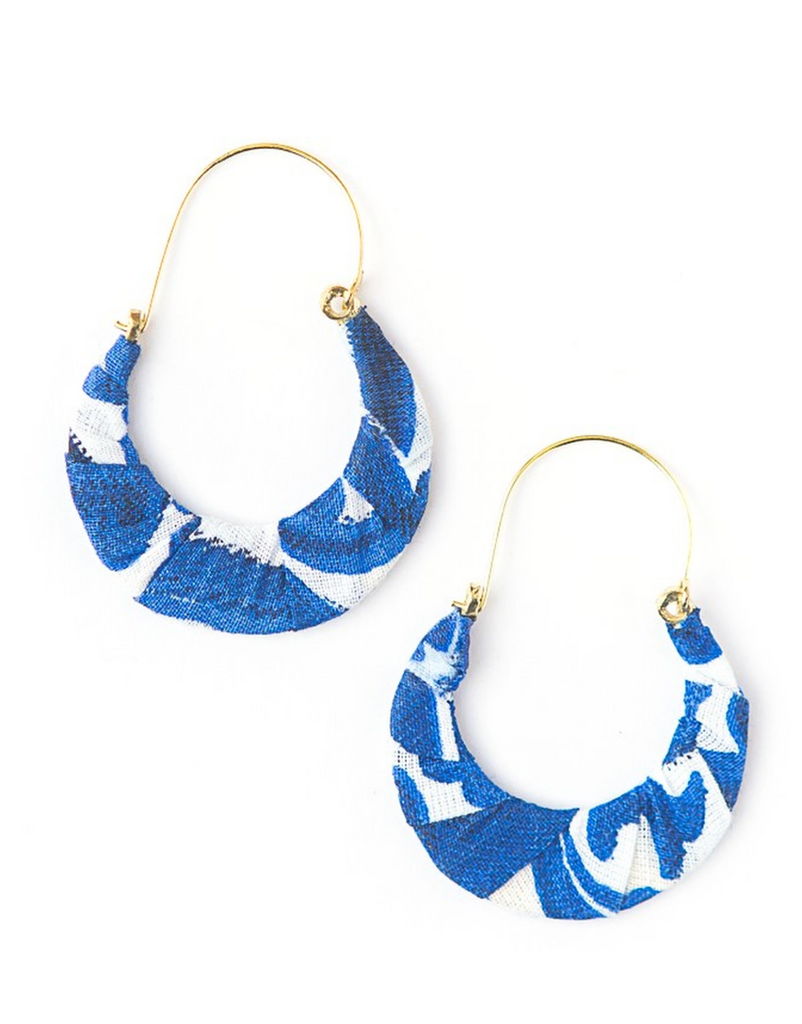 hoops with gold hardware and blue and white pattern fabric detailing on the bottom half top half goes up for ear like a hill shape bottom like a hoop with fabric