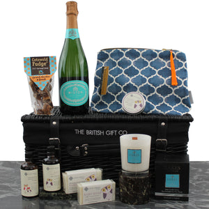 Baby Boy Gift Basket including new baby and new mum skin products, a candle, sparkling wine and fudge