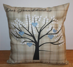 grandchildren family tree with blue hearts on a beige tartan cushion