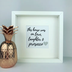 'This house runs on love, laughter and prosecco' framed print