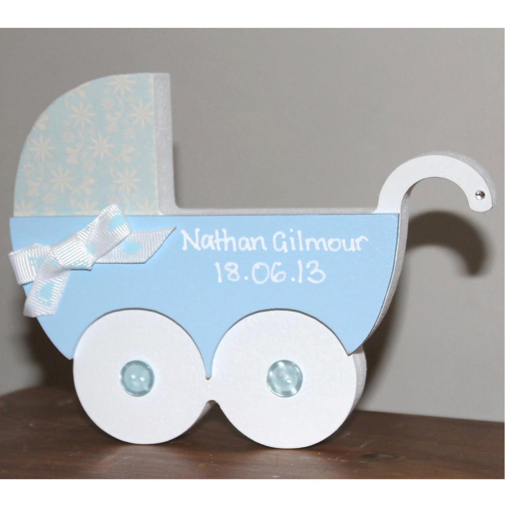 wooden pram painted blue and white and personalised with babies name and date of birth