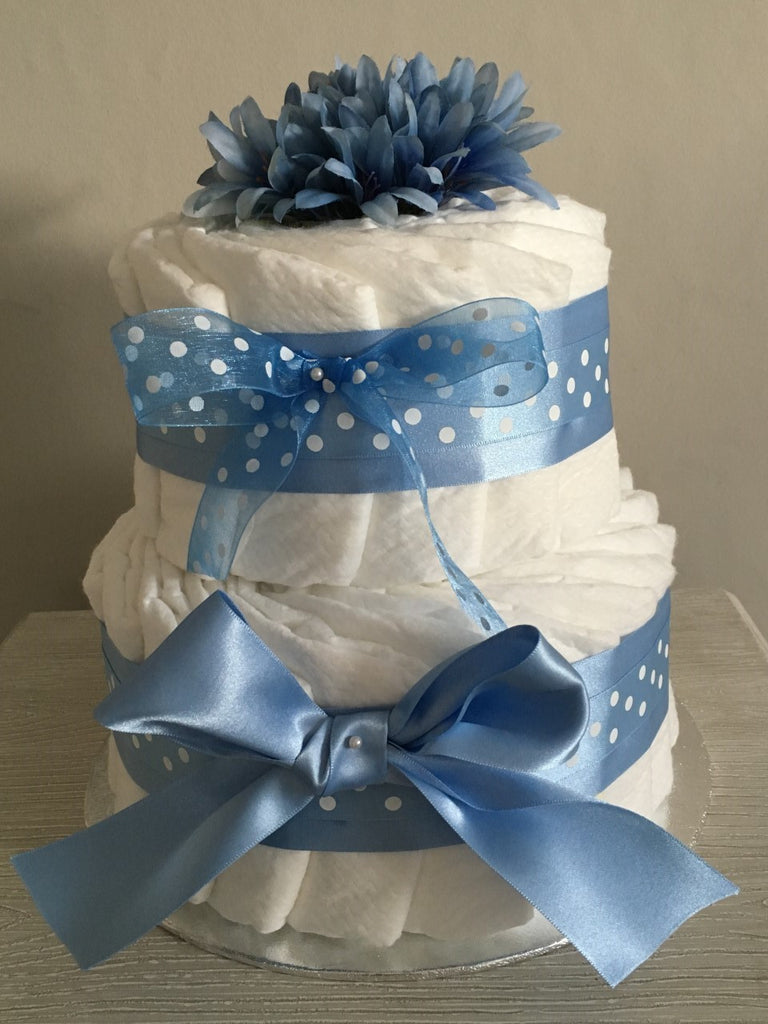 Gorgeous 2 Tier Nappy Cake Decorated with Beautiful Blue Ribbon and Silk Flower