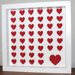 Framed picture with cut out paper hearts
