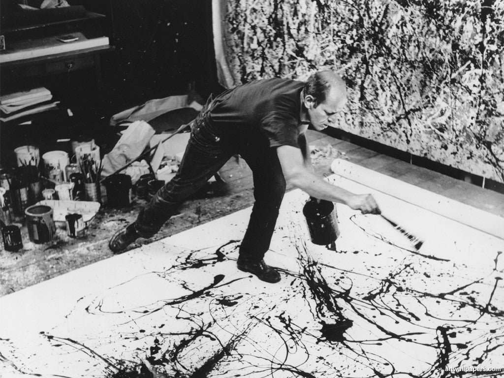 Jackson Pollock painting in action