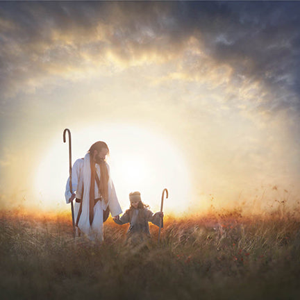 Christ and girl, who are holding staffs, walk through field while sun sets behind them
